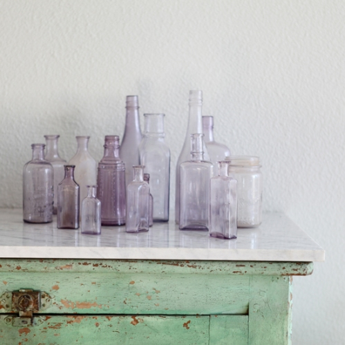 mismatched antique glass bottles