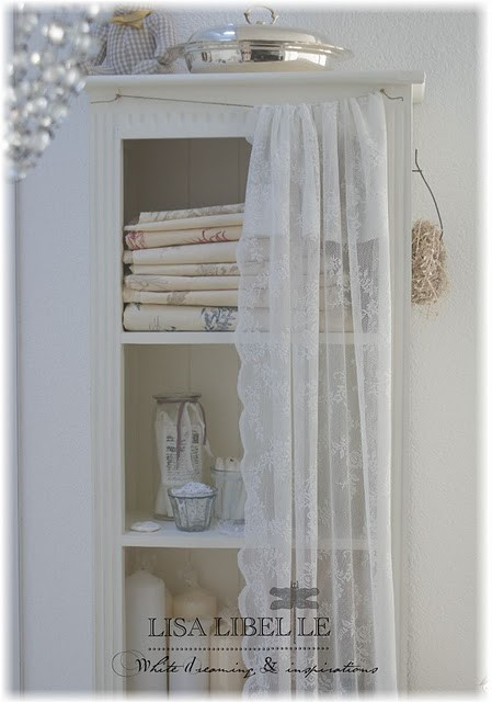 pretty lace curtains, vintage cabinet